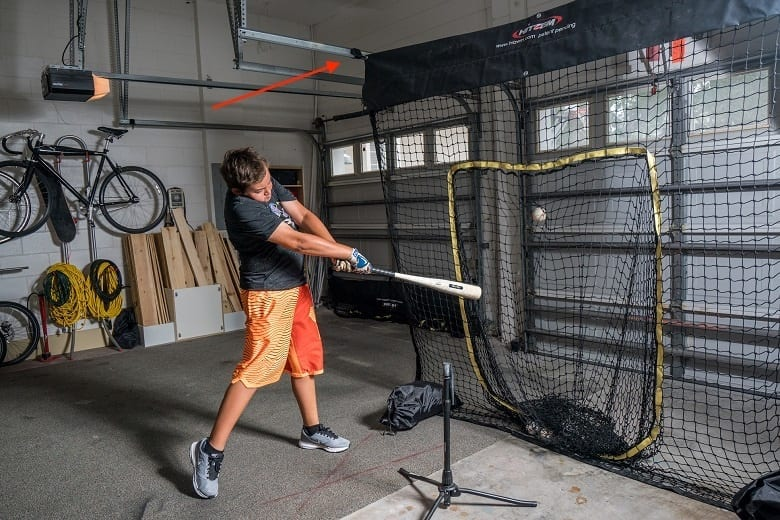 At home baseball practice in garage