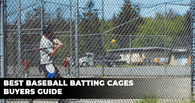 baseball player practicing batting inside a cage