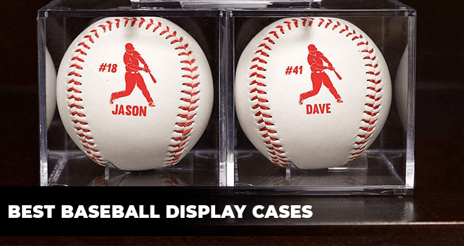 two baseballs in display cases