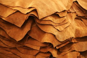 raw brown leather stacked on top of each other